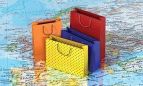 World shopping. Colorful package on the world map. Shopping tou