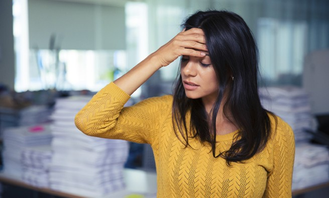 Businesswoman having headache in office