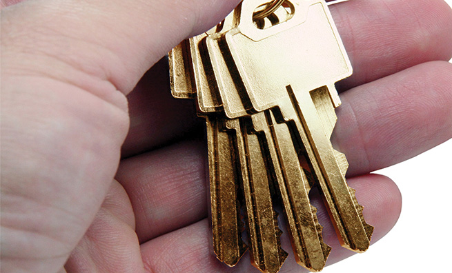 hand holding golden key