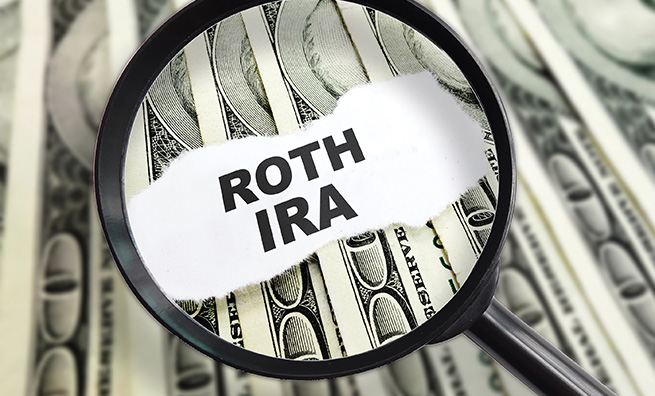 Magnified ROTH IRA message on hundred dollar bills