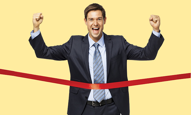 Full length portrait of successful businessman crossing finish line over white background. Vertical shot.