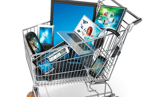Isolated shopping cart full of electronic equipment. (Notebook computer, tablet PCs, cell phones,TVs etc.)