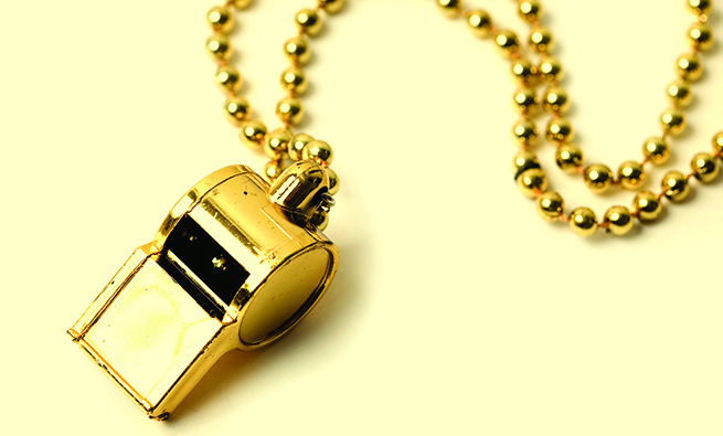 studio shot of gold whistle