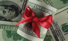 Close up concept image of money with red ribbon