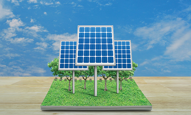 Solar cell from open book on wooden table over blue sky with white clouds, Ecological concept